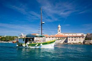 City-of-Krk-boat-tours-and-boat-in-front-of-the-port